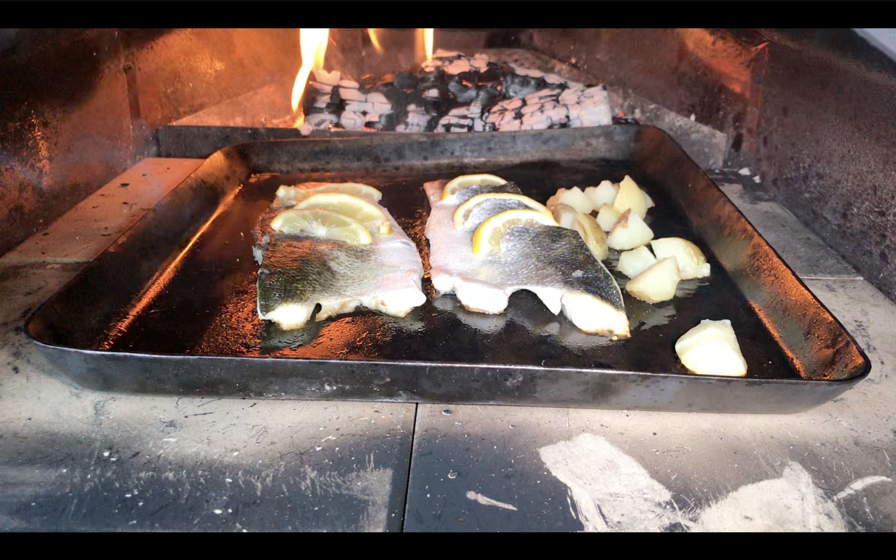 Cooking Sea Bass in the Ooni Wood and Gas-Fired Pizza Ovens